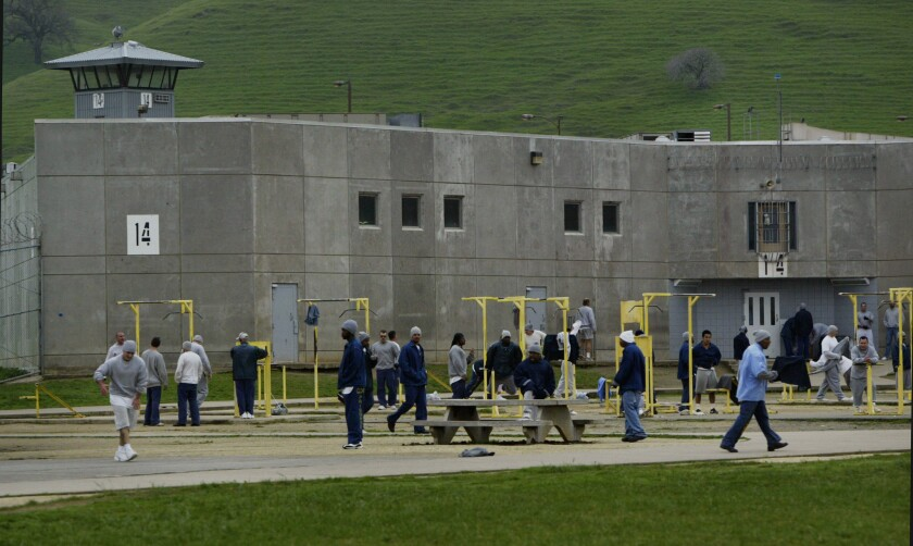 Inmates at an exercise yard at Solano State Prison in Vacaville in 2005. Gov. Jerry Brown proposes reducing California's use of private prisons as the inmate population drops.