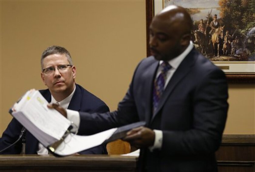 Defense attorney Walter Madison, right, cross examines Bureau of Criminal Investigation Special Agent Ed Lulla during a night session in the rape trial of Trent Mays, 17, and 16-year-old Ma'lik Richmond in juvenile court on Thursday, March 14, 2013 in Steubenville, Ohio. Mays and Richmond are accus