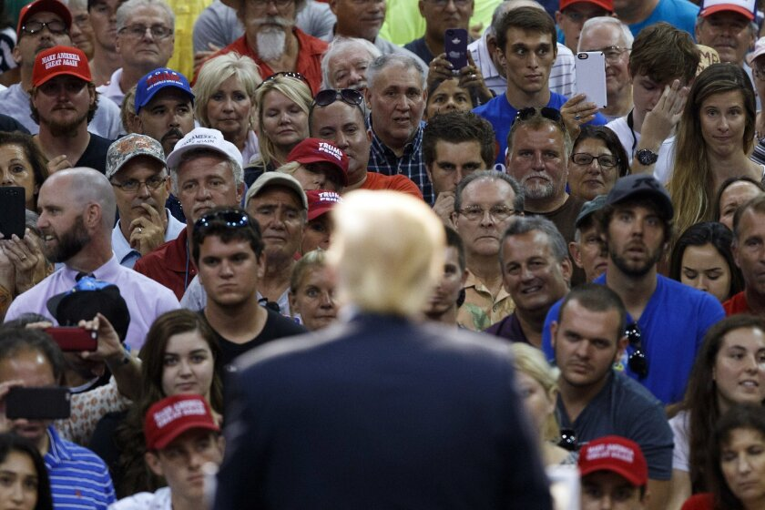 Republican presidential candidate Donald Trump speaks during a campaign town hall at Ocean Center, Wednesday, Aug. 3, 2016, in Daytona Beach, Fla. (AP Photo/Evan Vucci)