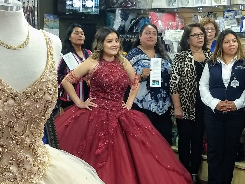 Gishly Santos, who celebrated her Quinceañeras last month, models her dress during a news conference in Escondido Tuesday concerning a public campaign warning parents not to allow underage drinking at such parties.