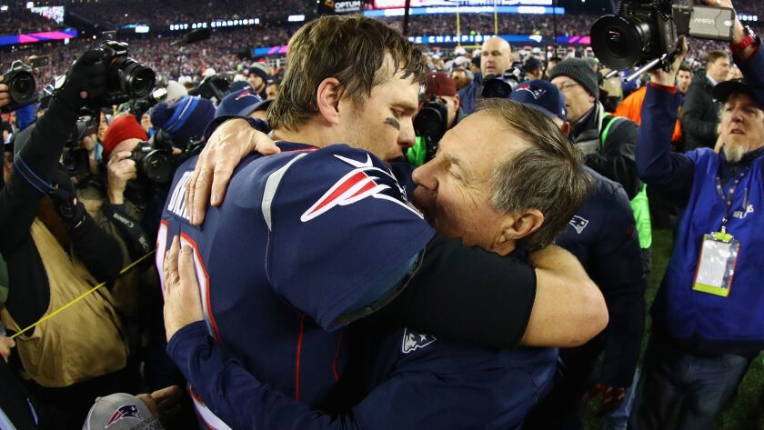 New England quarterback Tom Brady celebrates with head coach Bill Belichick after winning the AFC championship game against the Jacksonville Jaguars at Gillette Stadium on Sunday.