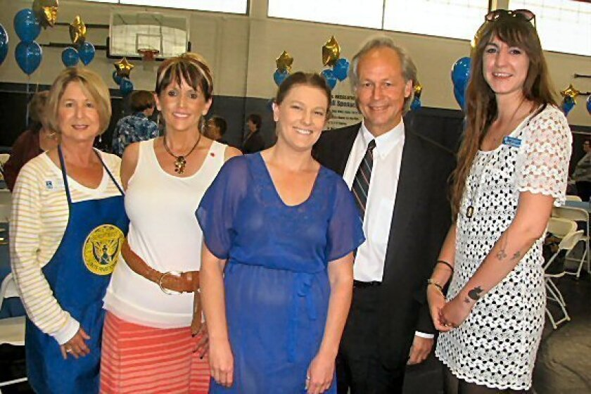 Mary Robotis, Tanya Gover, Hillary Adams, Daniel Foster and Amy Cailouette at the Oceanside-Carlsbad Soroptimist Salad Lunch on March 20 in Oceanside. CREDIT: Penny Bonnot
