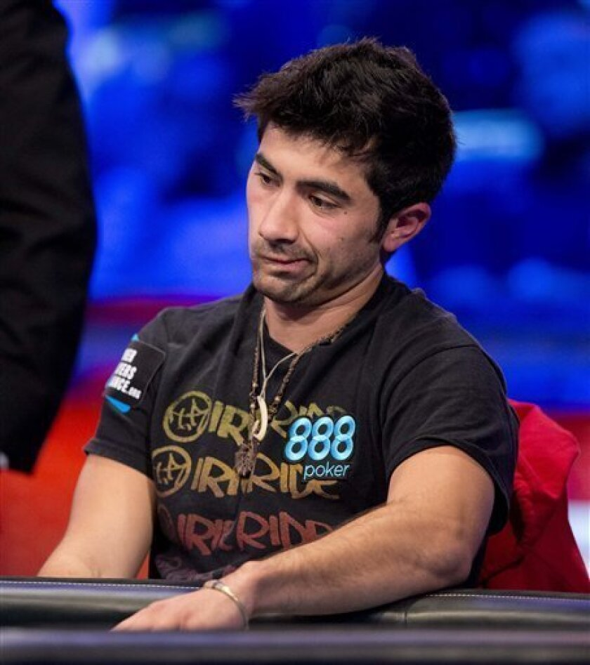 Jesse Sylvia watches play from his opponents during the World Series of Poker Final Table event, Tuesday, Oct. 30, 2012, in Las Vegas. (AP Photo/Julie Jacobson)