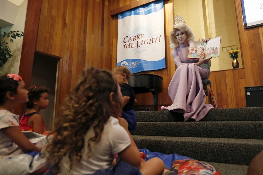 Drag queen Autumn Rose reads to children at Fairview Community Church in Costa Mesa on Wednesday.