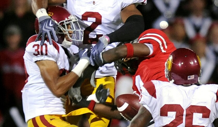USC cornerback Brian Baucham (30) and safety Taylor Mays (2) break up a pass intended for Ohio State's DeVier Posey during a game in 2009.