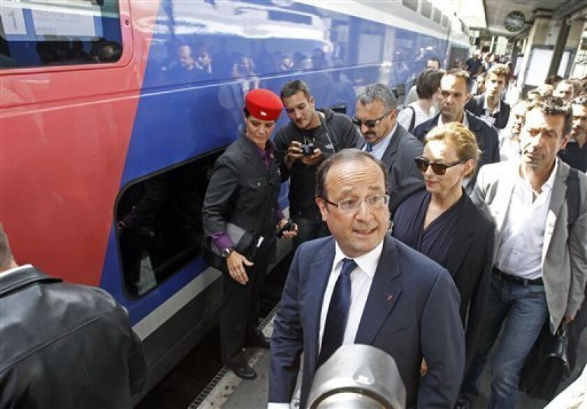 French President Francois Hollande arrives with his companion Valerie Trierweiler at the Gare de Lyon railway station in Paris, Thursday Aug. 2, 2012, to board a train bound for the French Riviera. Francois Hollande and Valerie Trierweiler will spend their summer holidays at the Fort de Bregancon state owned residence, located at Bormes-les-Mimosas.(AP Photo/Remy de la Mauviniere)
