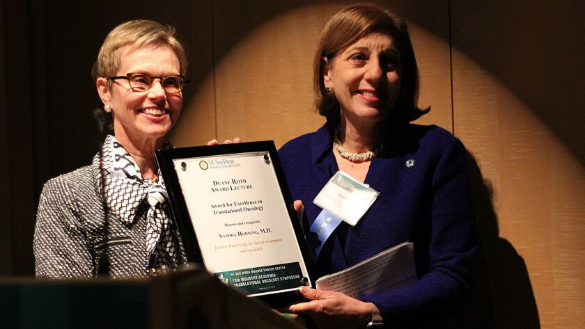 Sandra Horning, M.D., left, receives the Duane Roth Award by San Diego City Councilwoman Barbara Bry.