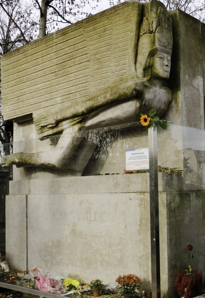 The tomb of Oscar Wilde, sculpted by American artist Jacob Epstein, at Père-Lachaise Cemetery in Paris.