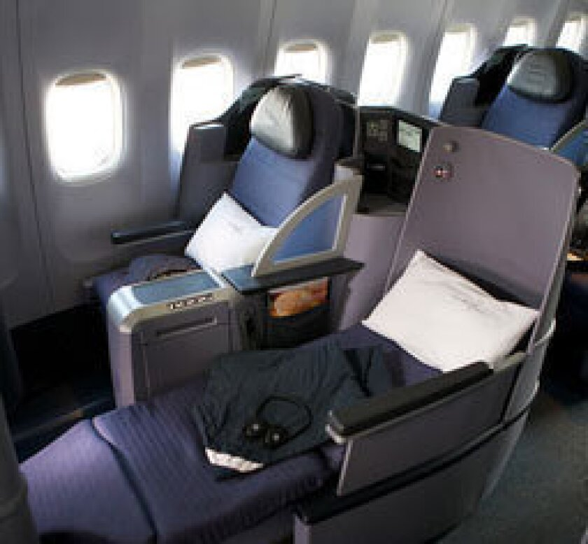 """United Airlines' lay-flat seats are featured in its new """"premium service."""""""