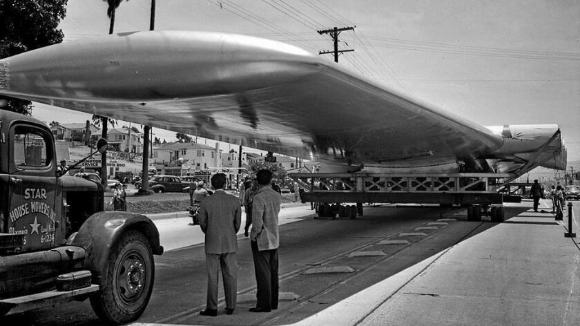 June 11, 1946: The wings of the Hughes Hercules aircraft sit in Hermosa Beach as the move is halted