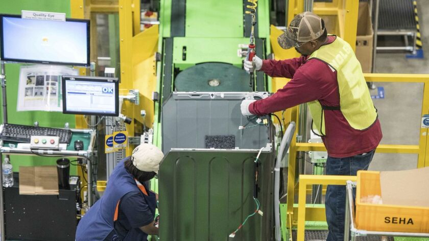 Workers build washing machines on the assembly line at a Samsung facility in South Carolina. U.S. manufacturing jobs increased in March.