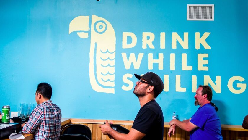 """""""Drink While Smiling"""" is the motto of Green Cheek Brewing, which gave the taproom a colorful makeove"""
