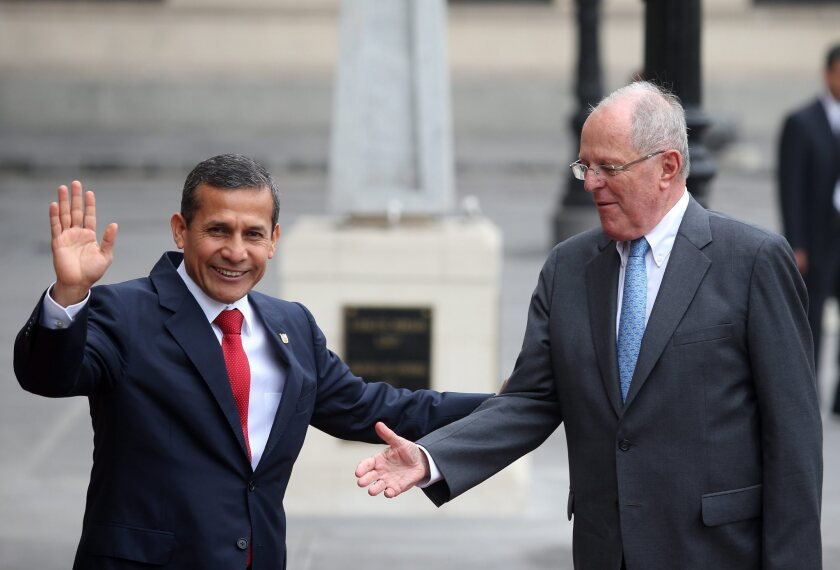 Peruvian President Ollanta Humala, left, receives Peruvian President-elect Pedro Pablo Kuczynski for a meeting and a private lunch at the Government Palace in Lima on June 22, 2016.