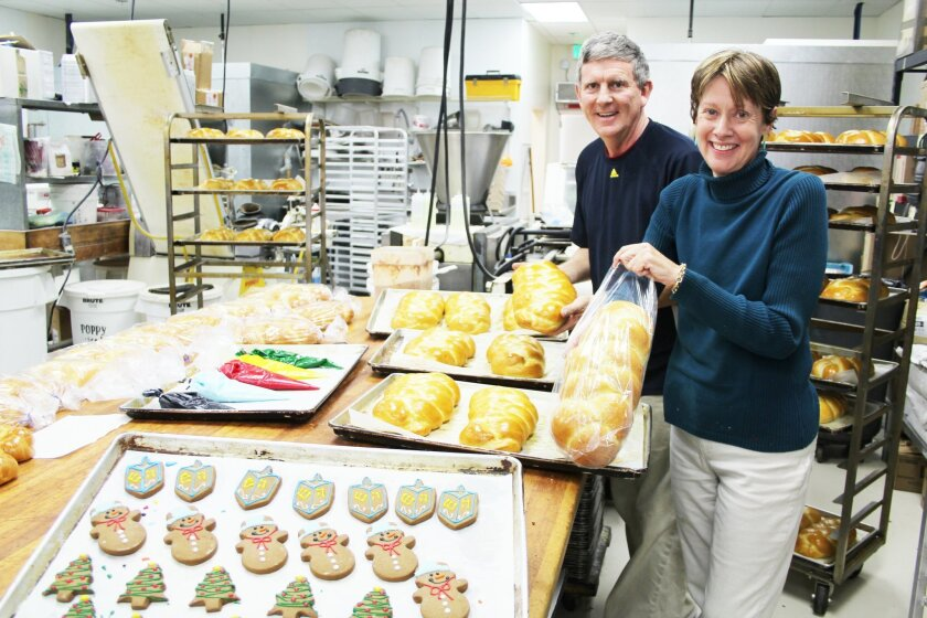 Parker and Sandra Pike show off their challah bread as well as a variety of holiday cookies (dreidels, snowmen and trees). The Pikes have been in Del Mar Highlands for almost 20 years. They recently moved the Village Mill Bread Company to a new location at the center between Jamba Juice and GameStop.