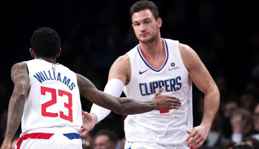 Forward Danilo Gallinari, being congratulated by guard Lou Williams after scoring against Brooklyn on Nov. 17, is cautioning that the Clippers have a long road ahead despite a strong start.