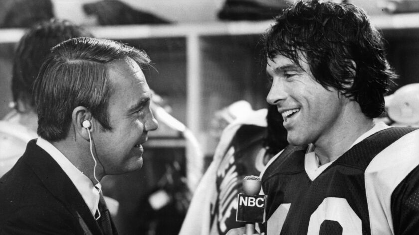 """Dick Enberg interviews Warren Beatty after a Super Bowl victory in a scene from the 1978 film """"Heaven Can Wait."""""""
