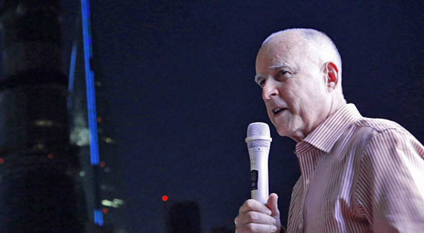 California Gov. Jerry Brown speaks on a tour boat during his visit to Huangpu River Saturday in Shanghai, China.