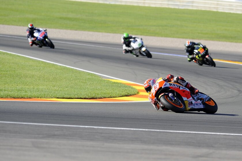 Spanish rider Marc Marquez leads during a qualifying session for Sunday's Valencia Motorcycle Grand Prix, the last race of the season, at the Ricardo Tormo circuit in Cheste near Valencia, Spain, Saturday Nov. 7, 2015. (AP Photo/Eduardo Manzana)