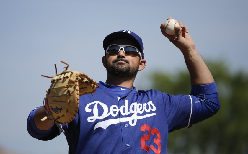 Dodgers' Adrian Gonzalez throws a spring training game against Milwaukee on Monday.