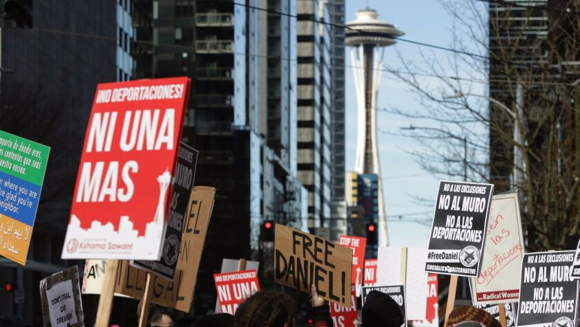 People march in Seattle to protest the detention of Daniel Ramirez Medina by immigration officials.