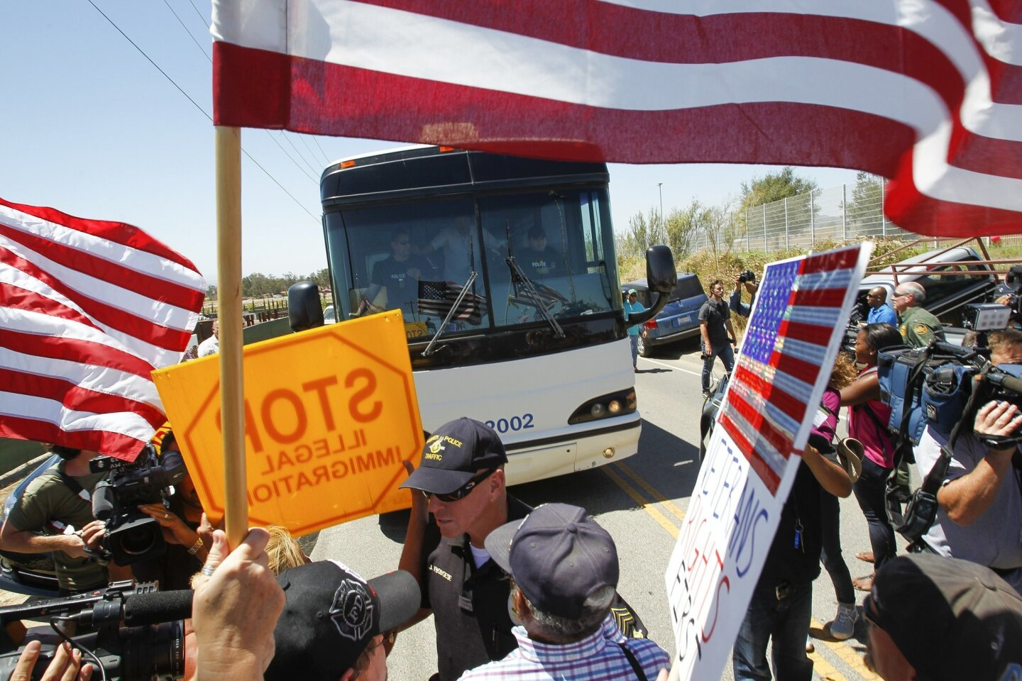 Detainees' Buses Blocked by Protesters