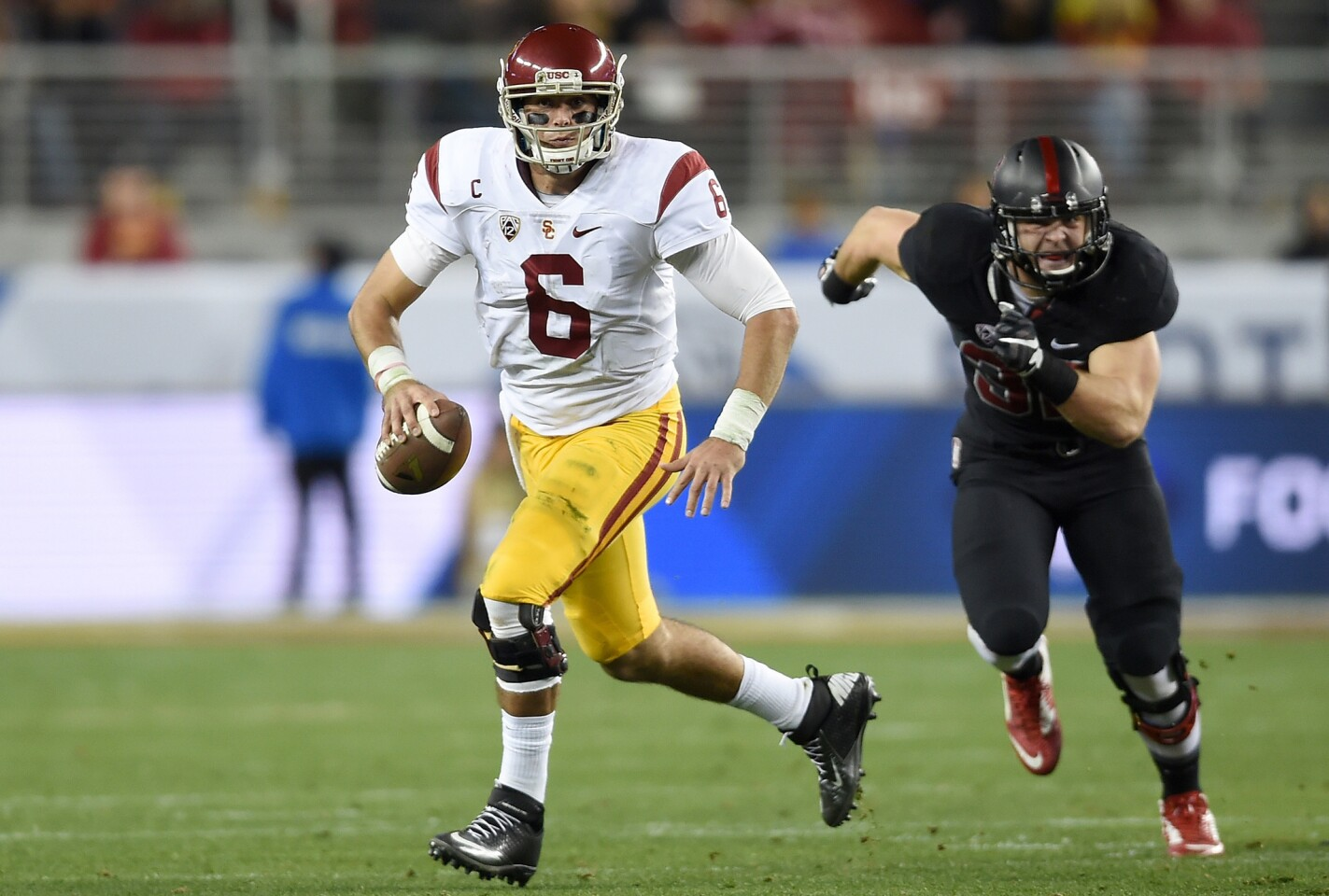 USC's Cody Kessler scrambles with the ball against Stanford during the second quarter of the Pac-12 Championship game at Levi's Stadium on Saturday.
