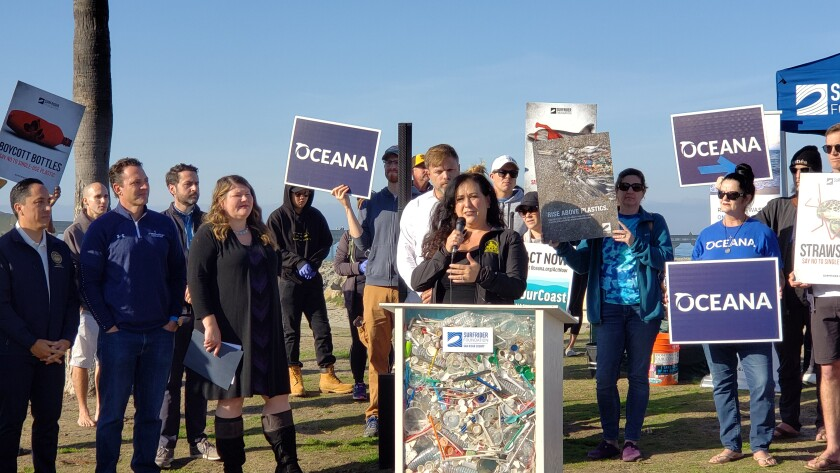 Assembly member Lorena Gonzalez-Fletcher (at the podium) explains AB1080, which she co-authored, while (from left) Assembly member Todd Gloria, County Supervisor Nathan Fletcher and Assembly member Tasha Boerner Horvath listen in.