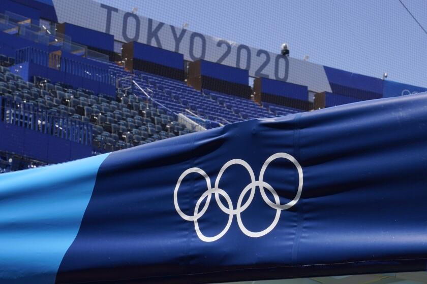 The Olympic Rings and a Tokyo 2020 sign are pictured inside Yokohama Baseball Stadium at the 2020 Summer Olympics, Wednesday, July 21, 2021, in Yokohama, Japan. (AP Photo/Sue Ogrocki)