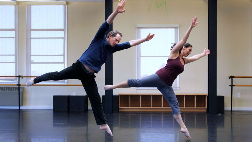 John Malashock, founder of Malashock Dance, left, rehearses with Lara Segura at the company's dance studio in the Liberty Station Arts District in March. Malashock Dance is one of dozens of San Diego arts institutions that could be affected next year by city budget cuts.