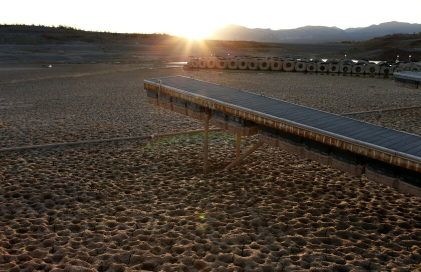 In this July 16, 2014 photo, a dock at what was once the Echo Bay Marina sits high and dry next to Lake Mead in the Lake Mead National Recreation Area in Nevada. A 14-year drought has caused the water level in Lake Mead to shrink to its lowest point since it was first filled in the 1930s. (AP Photo