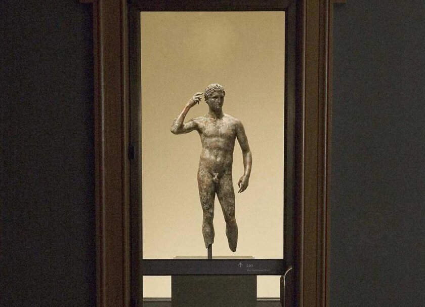 The 'Getty Bronze,' also known as 'Victorious Youth' on display at the Getty Villa antiquities museum. Italy's highest court has delayed a ruling on its fate.