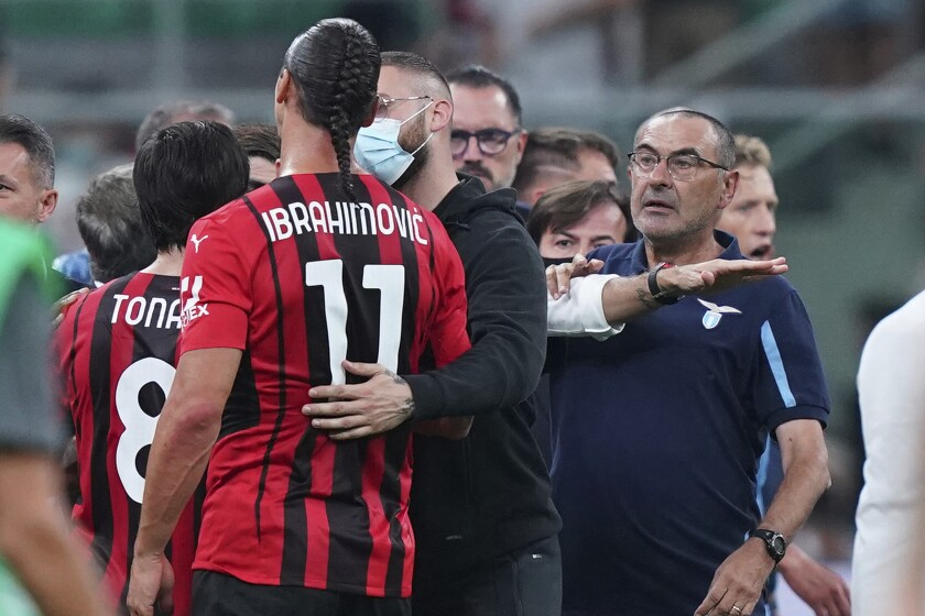 Lazio's coach Maurizio Sarri, right, gets a red card at the end of the Italian Serie A soccer match between Milan and Lazio at the San Siro stadium in Milan, Italy, Sunday, Sept. 12, 2021. (Spada/LaPresse via AP)