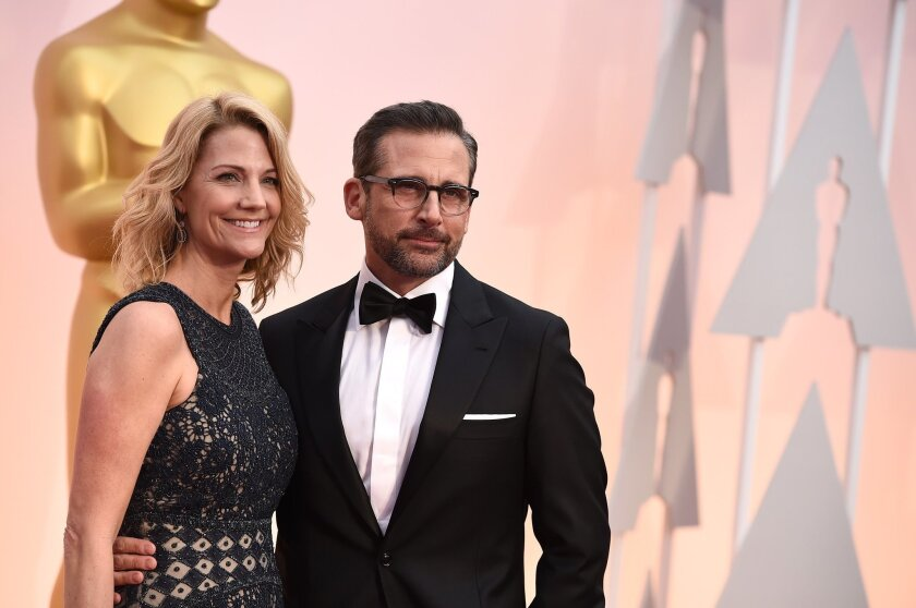 Steve Carell, right, and Nancy Carell arrive at the Oscars on Sunday, Feb. 22, 2015, at the Dolby Theatre in Los Angeles. (Photo by Jordan Strauss/Invision/AP)