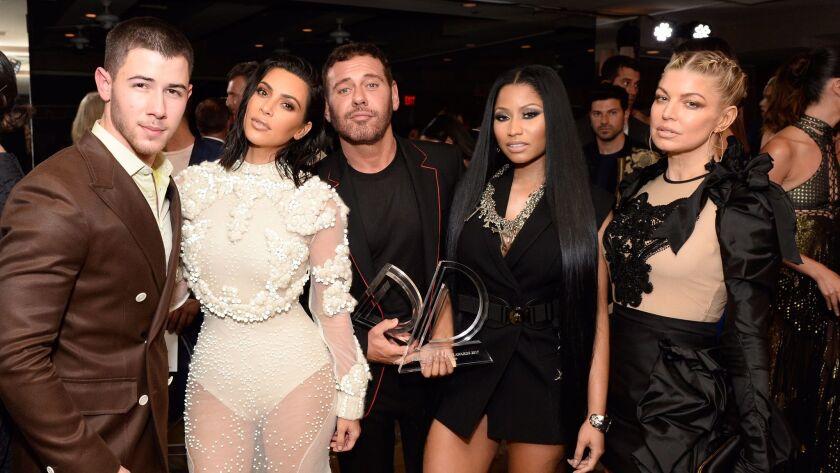 WEST HOLLYWOOD, CA - APRIL 02: (L-R) Host Nick Jonas, Kim Kardashian West, Nicki Minaj and Fergie a