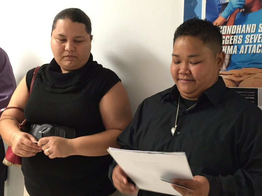 FILE - Loretta M. Pangelinan, 28, holds the application for a marriage license that she and her fiancee, Kathleen M. Aguero, 28, will turn in at the Office of Vital Statistics in the Guam Department of Public Health and Social Services in this April 8, 2015 file photo. Guam on Wednesday April 15, 2