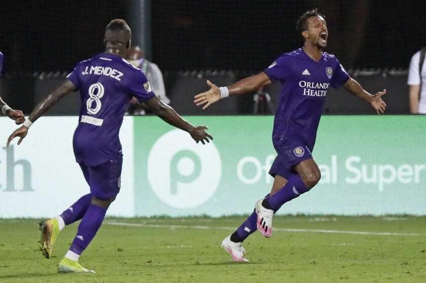 Orlando City's Nani, right, celebrates with Jhegson Medez after scoring against Inter Miami on Wednesday in Kissimmee, Fla.