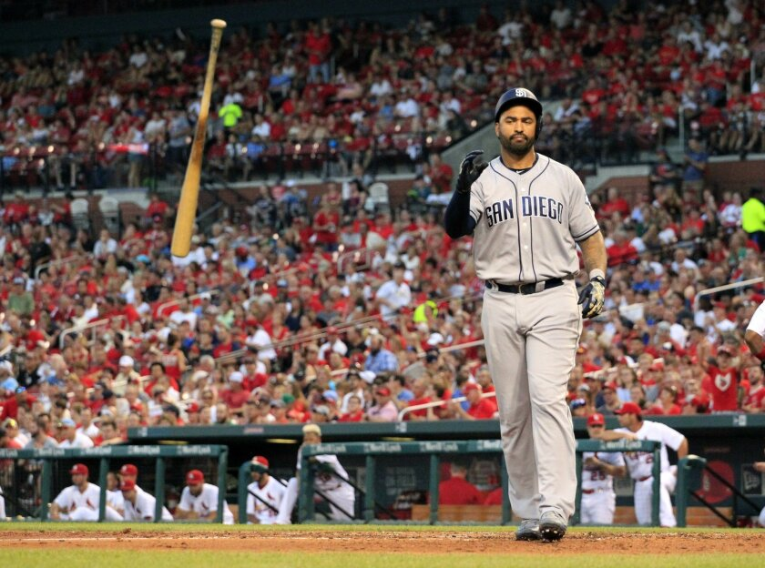 San Diego Padres' Matt Kemp tosses his bat after striking out to end the top of the third inning in the second game of a baseball doubleheader against the St. Louis Cardinals Wednesday, July 20, 2016, in St. Louis. (AP Photo/Jeff Roberson)