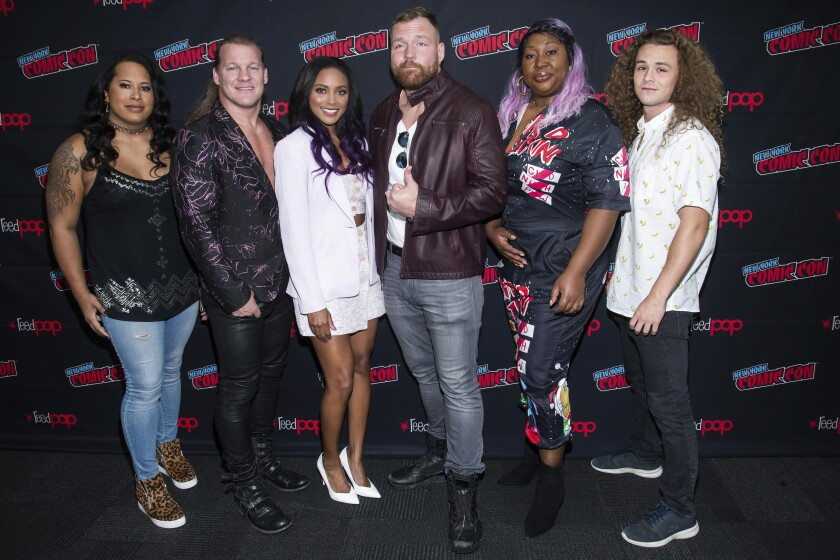"""FILE - In this Friday, Oct. 4, 2019, file photo, Nyla Rose, from left, Chris Jericho, Brandi Rhodes, Jon Moxley, Awesome Kong and Jungle Boy attend New York Comic Con to promote TNT's """"All Elite Wrestling: Dynamite,"""" at the Jacob K. Javits Convention Center, in New York. All Elite Wrestling is set to celebrate its one-year anniversary with a show from Daily's Place in Jacksonville, Fla., on Wednesday, Oct. 14, 2020. (Photo by Charles Sykes/Invision/AP, File)"""