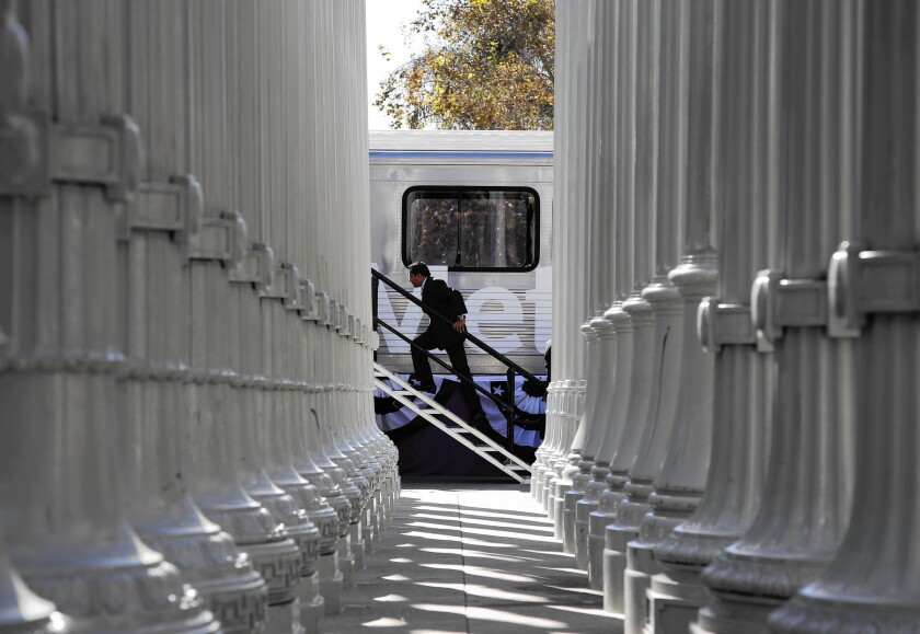 A replica rail car sits in front of the LACMA during a groundbreaking ceremony for the city's subway extension to the west.