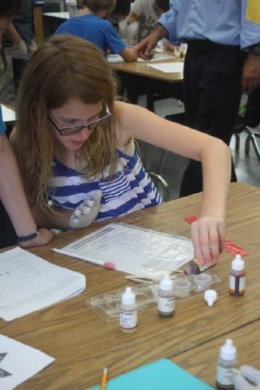 Arielle Bark tests blood samples and determines whether it clots to figure out what blood type it is.