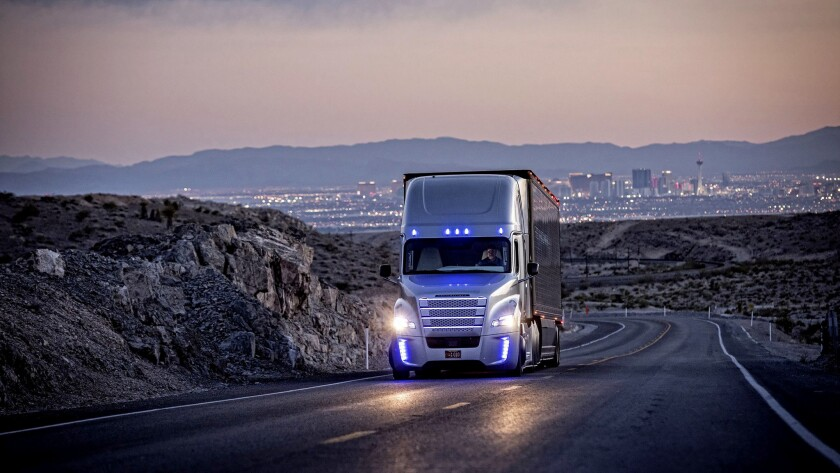 A driver operates a Freightliner truck on a road outside Las Vegas. Freightliner parent Daimler AG i