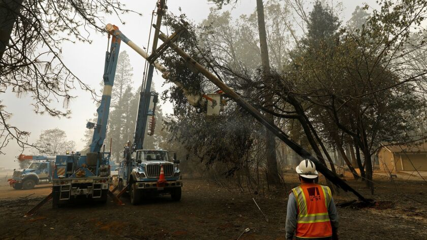 Crews work on power lines after the Camp fire, the deadliest and most destructive wildfire in state history. The November fire in Butte County in Northern California could push PG&E into bankruptcy.