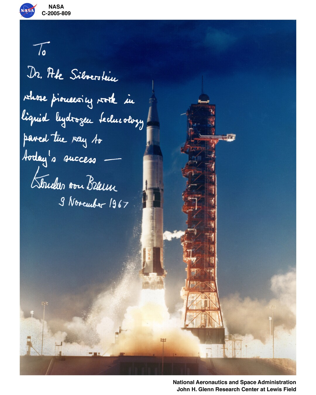 Signed photographic print of a Saturn 5 launch