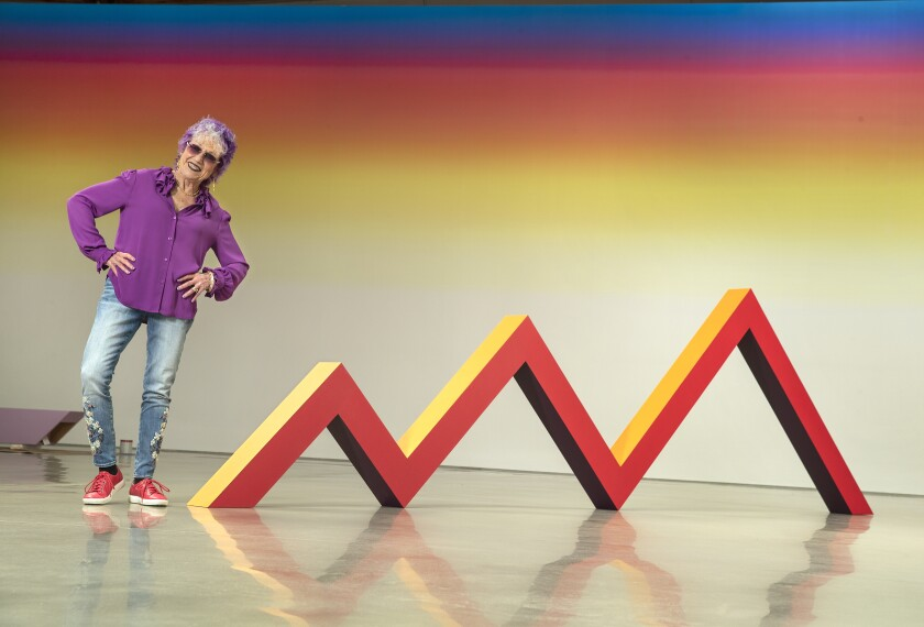 "Artist Judy Chicago next to her piece ""Zig Zag,"" acrylic on canvas-covered plywood, from 1965, remade in 2019, on display at Deitch gallery in Hollywood."