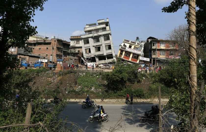 Damaged buildings teeter to their sides in Katmandu, Nepal, after a 7.8 earthquake.