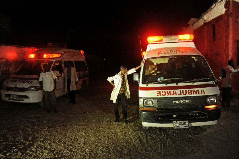 Two ambulances stand near the scene of an armed attack on a restaurant in Mogadishu, Somalia, on Jan. 21.