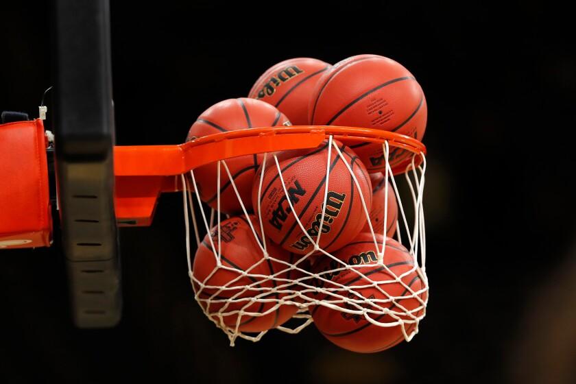 Basketballs fill a net