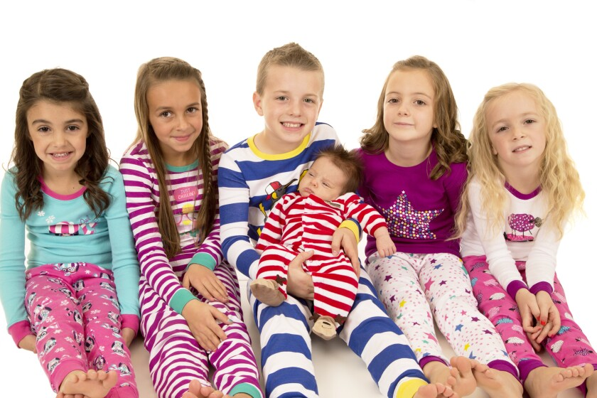 Six children wearing winter pajamas