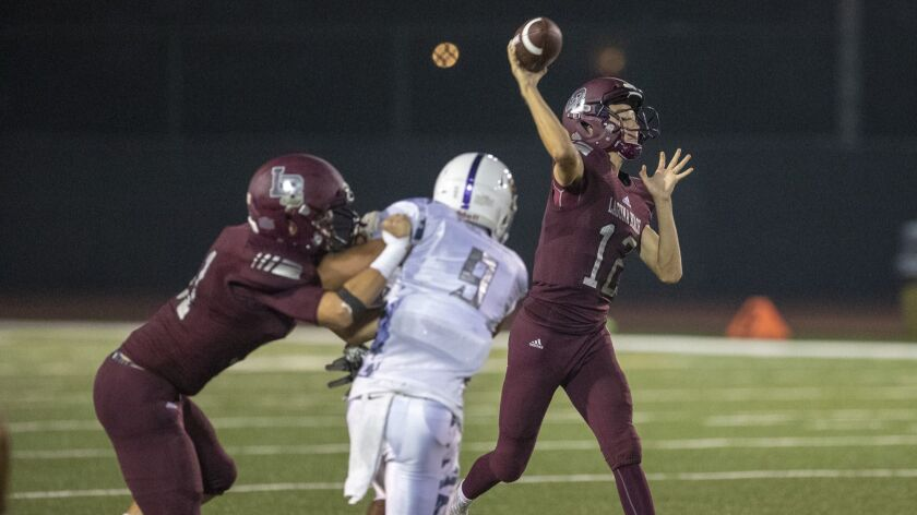 Laguna Beach's Andrew Johnson passes during a game against Hoover during on Friday, August 24.