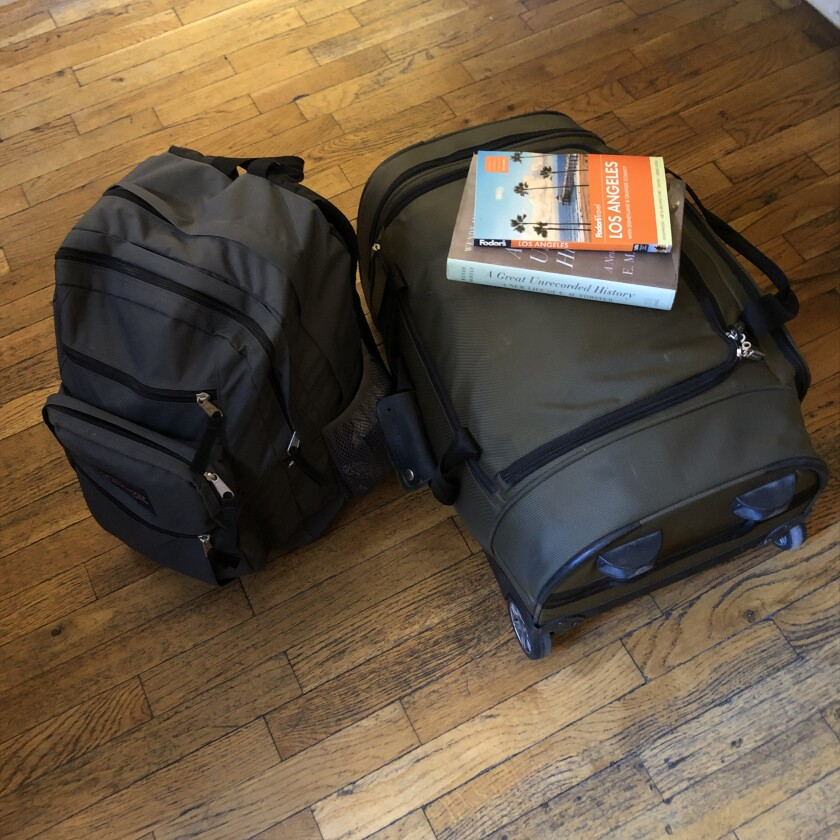 The key to moving from Airbnb to Airbnb is traveling light. For six months, the author lived out of a small suitcase and a large backpack.